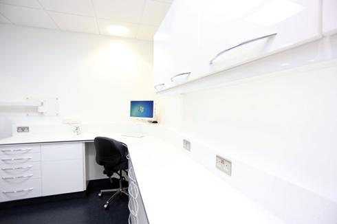 Desk and computer, Charles Landau dental practice refurbishment