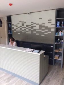 Receptionist at reception desk at Cockfosters Dental Practice