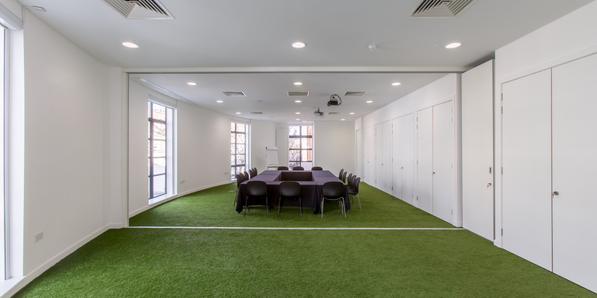 meeting room with grass effect carpet museum of london refurbishment demonstrating intuitive office design and refurbishment