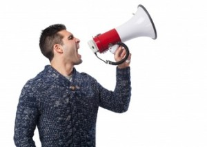 man-shouting-through-a-megaphone : opening a dental practice