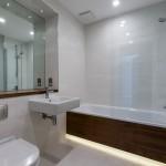 Cornwall Works modern bathroom with shower over bath and heated towel rail