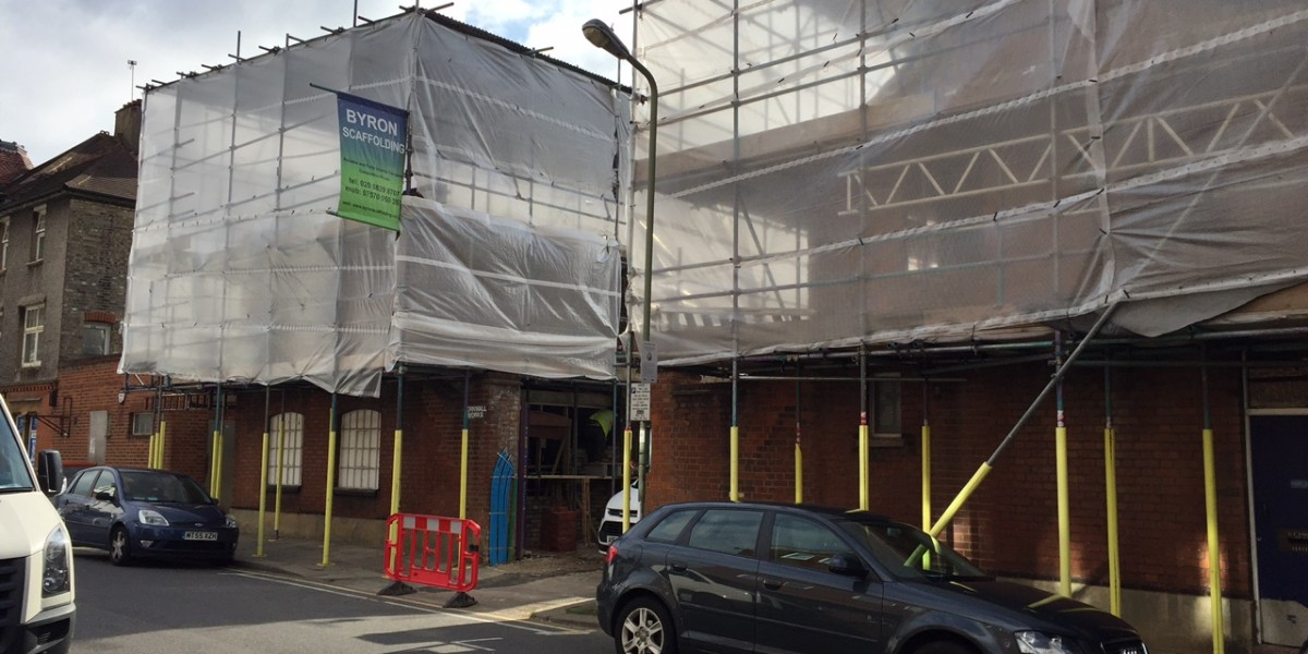 Exterior view of scaffolded building site at Cornwall Works