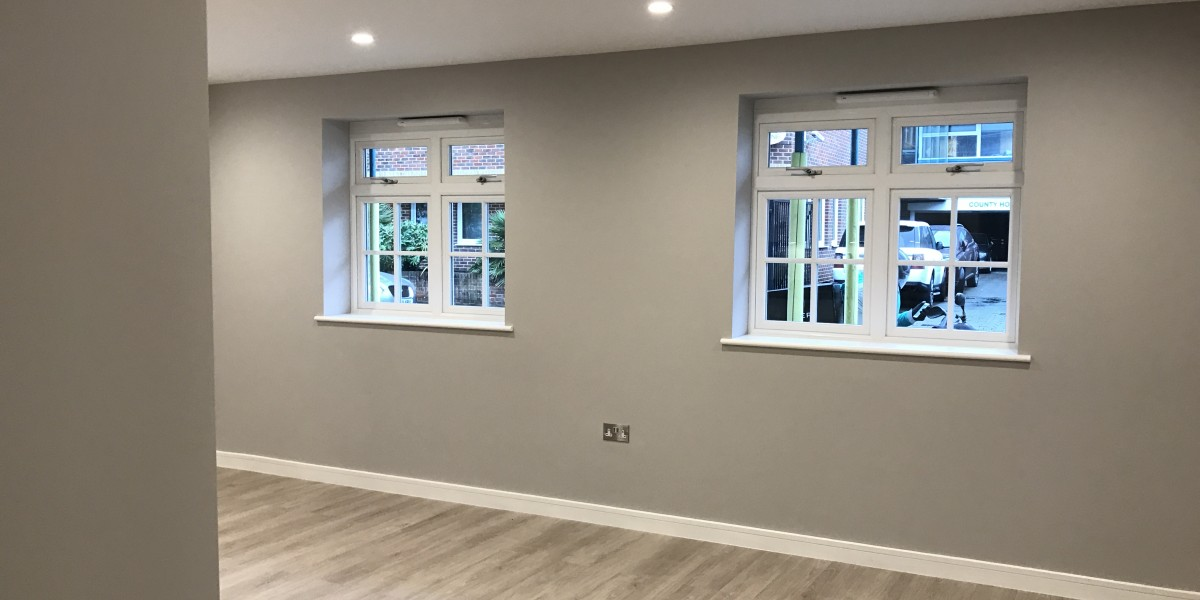 Mid grey wall with two windows at Cornwall Works
