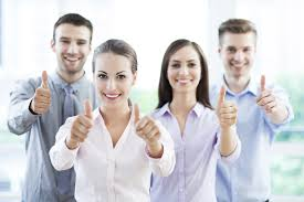 Four smiling people with thumbs up
