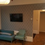 Waiting area with teal seating at The Dental Centre, Tulse Hill
