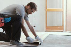 man fitting vinyl flooring