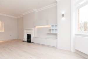 Shelves and fireplace in living room, Goldhurst Terrace apartment refurbishment