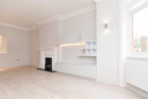 Shelves and fireplace in living room, Goldhurst Terrace apartment refurbishment