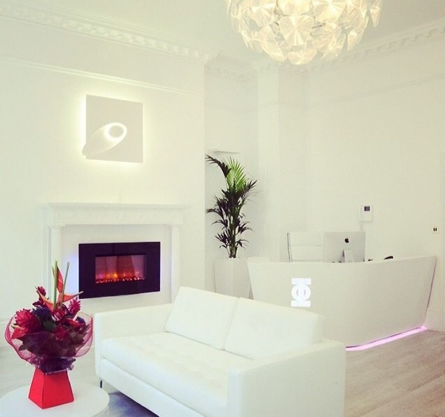 Sofa and fireplace in Harley street surgery interior design