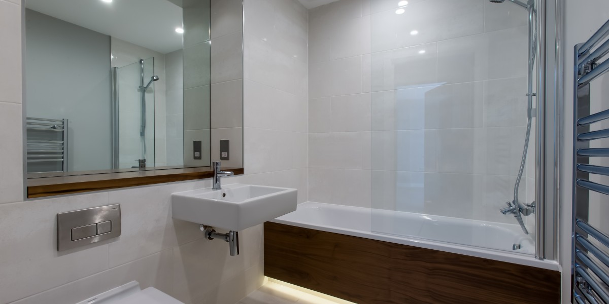 Cornwall Works modern bathroom with shower over bath and heated towel rail