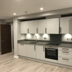 Modern white compact kitchen at Cornwall Works