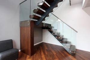 Glass staircase with dark wood steps