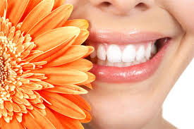 Close up of woman smiling with gerbera