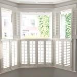 White shutters on bay window