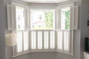 White shutters on bay window