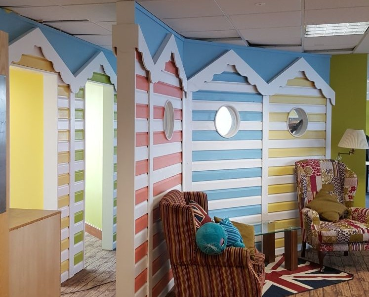 Beach hut themed holiday company headquarters after Retail Office Relocation