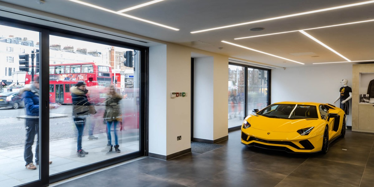 Passersby looking at Lamborghinis in refurbished South Kensington showroom