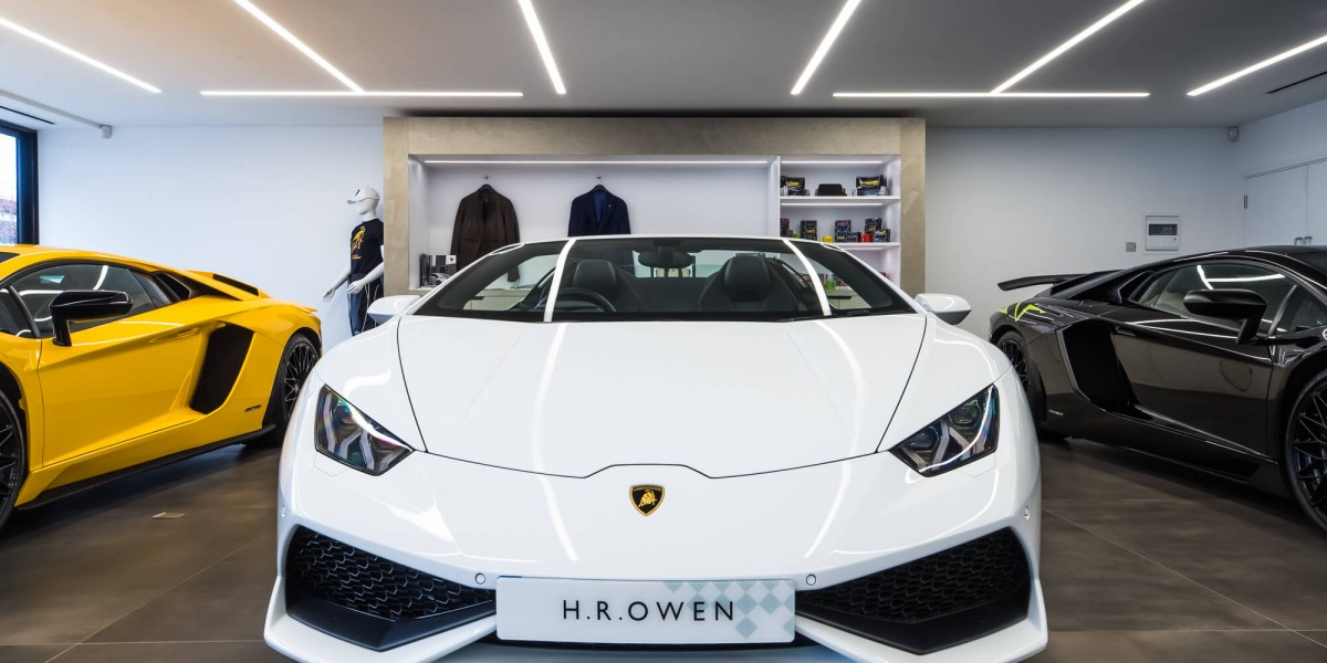Close up of white Lamborghini in refurbished South Kensington showroom