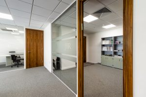 Glass partition and wooden door at JBR Capital, Finchley Road, London
