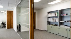 An office with glass partition at JBR Capital, Finchley Road, London