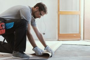 man fitting vinyl flooring