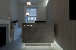 Marble effect reception desk with LED lighting