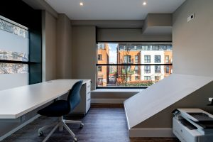 Interior of office space featuring a desk and chair