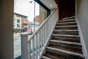 Bespoke timber staircase at Angle House dental clinic, Harrow