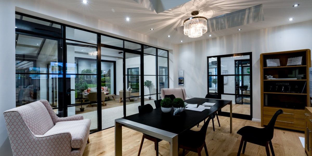 Room set featuring black frame windows at HBD Systems showroom
