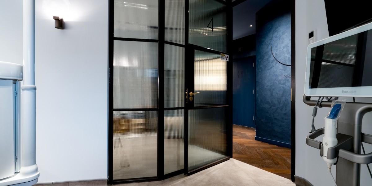 FABCO black metal framed partition panels in dental clinic