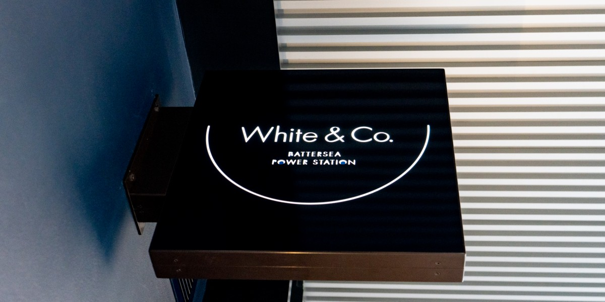 Exterior signage for White & co