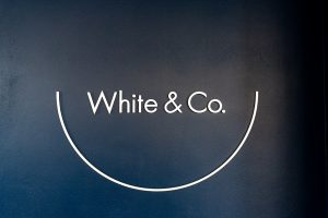 White & Co logo signage