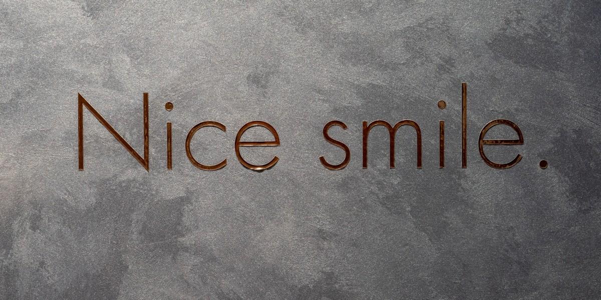 Signage reading nice smile